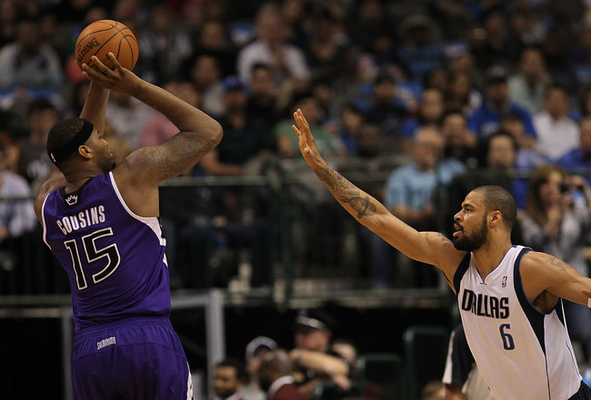 DALLAS, TX - FEBRUARY 16:  Forward DeMarcus Cousins #15 of the Sacramento Kings takes a shot against Tyson Chandler #6 of the Dallas Mavericks at American Airlines Center on February 16, 2011 in Dallas, Texas.  NOTE TO USER: User expressly acknowledges an