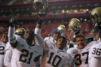 PISCATAWAY, NJ - OCTOBER 16: Buddy Jackson #21, Aundre Wright #10, and Joe Capp #37 of the University of Pittsburgh Panthers celebrate after their win against the Rutgers University Scarlett Knights on October 16, 2009 at Rutgers Stadium in Piscataway, Ne