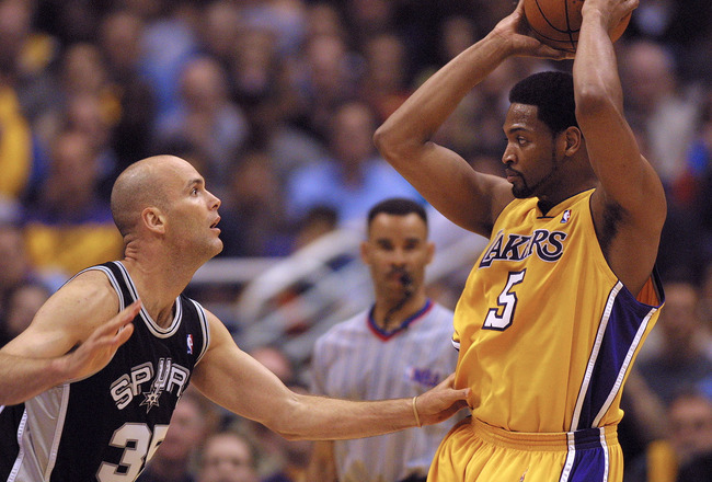 25 May 2001:  Robert Horry #5 of the Los Angeles Lakers is defended by Danny Ferry #35 of the San Antonio Spurs during the first quarter of game three in the western conference finals at the Staples Center in Los Angeles, California.  DIGITAL IMAGE. Manda