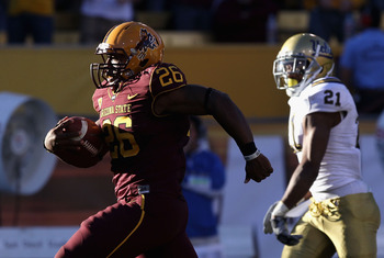 TEMPE, AZ - NOVEMBER 26:  Runningback Cameron Marshall #26 of the Arizona State Sun Devils carries the football for a 71 yard rushing touchdown against the UCLA Bruins during the thrid quarter of the college football game at Sun Devil Stadium on November