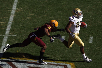 TEMPE, AZ - NOVEMBER 26:  Runningback Johnathan Franklin #23 of the UCLA Bruins carries the ball for a 55 yard rush past Omar Bolden #3 of the Arizona State Sun Devils during the first quarter of the college football game at Sun Devil Stadium on November
