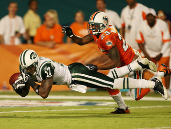MIAMI - OCTOBER 12:  Wide receiver Braylon Edwards #17 of the New York Jets can't come up with a catch after being interfered with by cornerback Will Allen #25 of the Miami Dolphins at Land Shark Stadium on October 12, 2009 in Miami, Florida. The Dolphins