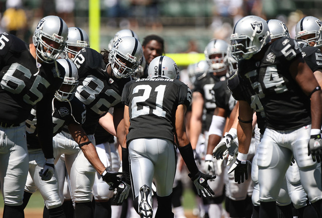 OAKLAND, CA - AUGUST 29:  Nnamdi Asomugha #21 of the Oakland Raiders is introduced against the New Orleans Saints during an NFL preseason game at Oakland-Alameda County Coliseum on August 29, 2009 in Oakland, California.  (Photo by Jed Jacobsohn/Getty Ima