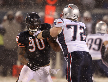 CHICAGO, IL - DECEMBER 12: Julius Peppers #90 of the Chicago Bears rushes against Matt Light #72 of the New England Patriots at Soldier Field on December 12, 2010 in Chicago, Illinois. The Patriots defeated the Bears 36-7. (Photo by Jonathan Daniel/Getty