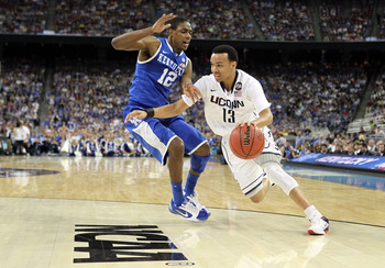HOUSTON, TX - APRIL 02:  Shabazz Napier #13 of the Connecticut Huskies drives on Brandon Knight #12 of the Kentucky Wildcats during the National Semifinal game of the 2011 NCAA Division I Men's Basketball Championship at Reliant Stadium on April 2, 2011 i