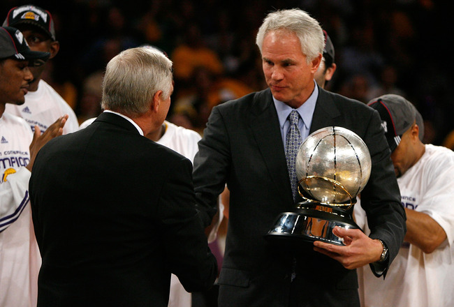 LOS ANGELES, CA - MAY 29:  (L-R) NBA legend Jerry West shakes hands with Los Angeles Lakers general manager Mitch Kupchak after defeating the Lakers defeated the San Antonio Spurs 100-92 in Game Five of the Western Conference Finals during the 2008 NBA Pl