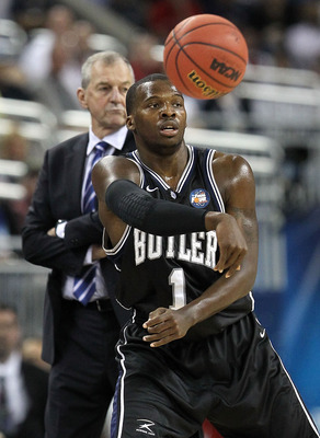 HOUSTON, TX - APRIL 04:  Shelvin Mack #1 of the Butler Bulldogs passes the ball while taking on the Connecticut Huskies during the National Championship Game of the 2011 NCAA Division I Men's Basketball Tournament at Reliant Stadium on April 4, 2011 in Ho
