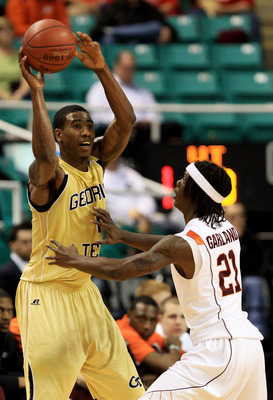GREENSBORO, NC - MARCH 10:  Iman Shumpert #1 of the Georgia Tech Yellow Jackets looks to pass against Tyrone Garland #21 of the Virginia Tech Hokies during the first half of the game in the first round of the 2011 ACC men's basketball tournament at the Gr