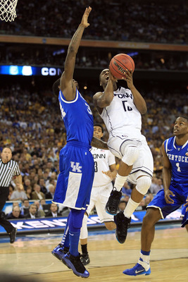 HOUSTON, TX - APRIL 02:  Kemba Walker #15 of the Connecticut Huskies goes to the hoop against DeAndre Liggins #34 of the Kentucky Wildcats during the National Semifinal game of the 2011 NCAA Division I Men's Basketball Championship at Reliant Stadium on A