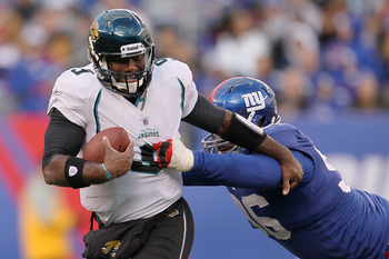 EAST RUTHERFORD, NJ - NOVEMBER 28:  David Garrard #9 of the Jacksonville Jaguars is sacked by Barry Cofield #96 of the New York Giants at New Meadowlands Stadium on November 28, 2010 in East Rutherford, New Jersey.  (Photo by Chris McGrath/Getty Images)