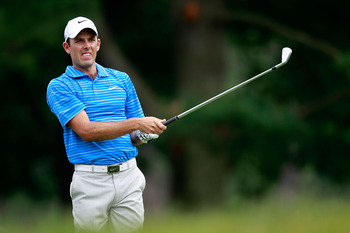 BETHESDA, MD - JUNE 16:  Charl Schwartzel of South Africa hits a shot on the second hole during the first round of the 111th U.S. Open at Congressional Country Club on June 16, 2011 in Bethesda, Maryland.  (Photo by Chris Trotman/Getty Images)