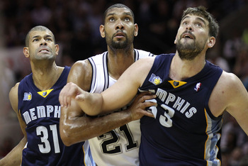 SAN ANTONIO, TX - APRIL 27:  Tim Duncan #21 of the San Antionio Spurs battles for a rebound against Shane Battier #31 and Marc Gasol #33 of the Memphis Grizzlies in Game Five of the Western Conference Quarterfinals in the 2011 NBA Playoffs on April 27, 20