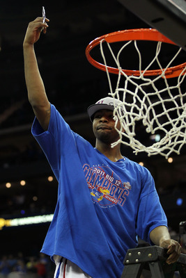 KANSAS CITY, MO - MARCH 12:  Marcus Morris #22 of the Kansas Jayhawks cuts down the net after defeating the Texas Longhorns 85-73 in the 2011 Phillips 66 Big 12 Men's Basketball Tournament championship game at Sprint Center on March 12, 2011 in Kansas Cit