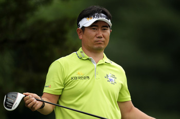 BETHESDA, MD - JUNE 16:  Y.E. Yang of South Korea watches his tee shot on the 14th hole during the first round of the 111th U.S. Open at Congressional Country Club on June 16, 2011 in Bethesda, Maryland.  (Photo by Ross Kinnaird/Getty Images)