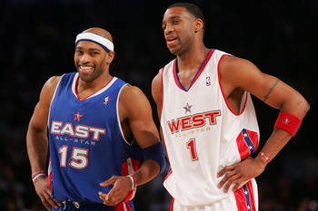 DENVER - FEBRUARY 20:   Vince Carter #15 of the Eastern Conference All-Stars laughs with Tracy McGrady #1 of the Western Conference All-Stars during the 54th All-Star Game, part of 2005 NBA All-Star Weekend at Pepsi Center on February 20, 2005 in Denver,