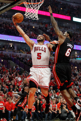CHICAGO, IL - MAY 15:  Carlos Boozer #5 of the Chicago Bulls drives for a shot attempt against LeBron James #6 of the Miami Heat in Game One of the Eastern Conference Finals during the 2011 NBA Playoffs on May 15, 2011 at the United Center in Chicago, Ill