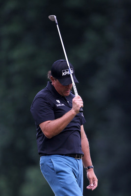 BETHESDA, MD - JUNE 16:  Phil Mickelson reacts to missing a chip shot on the 18th hole during the first round of the 111th U.S. Open at Congressional Country Club on June 16, 2011 in Bethesda, Maryland.  (Photo by Jamie Squire/Getty Images)