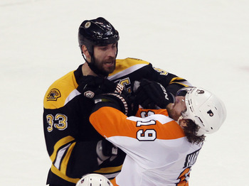 BOSTON, MA - MAY 06:  Zdeno Chara #33 of the Boston Bruins exchanges blows with Scott Hartnell #19 of the Philadelphia Flyers in Game Four of the Eastern Conference Semifinals during the 2011 NHL Stanley Cup Playoffs at TD Garden on May 6, 2011 in Boston,