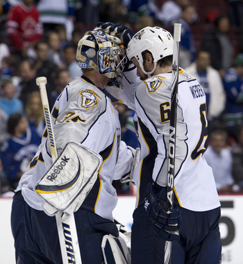 VANCOUVER, CANADA - MAY 7: Goalie Pekka Rinne #35 of the Nashville Predators if congratulated by Shea Weber #6 after defeating the Vancouver Canucks 4-3 in Game Five of the Western Conference Semifinals during the 2011 NHL Stanley Cup Playoffs on May 07,