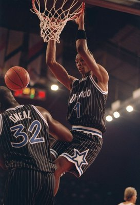 Oct 1993:  Center Shaquille O''Neal of the Orlando Magic (left) ducks the ball after teammate guard Anfernee Hardaway slam dunks it during a game against the Atlanta Hawks at Wembley Stadium in London, England. Mandatory Credit: Mike Cooper  /Allsport