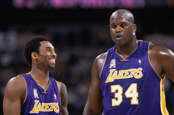 22 Nov 2001:  Guard Kobe Bryant #8 of the Los Angeles Lakers talks with his teammate, center Shaquille O''Neal #34, during the NBA game against the Denver Nuggets at the Pepsi Center in Denver, Colorado. The Lakers defeated the Nuggets 89-68.  NOTE TO USE