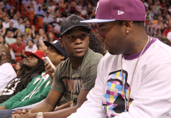 MIAMI, FL - NOVEMBER 29:  Boxer Floyd Mayweather Jr watches a game between the  Miami Heat and the Washington Wizards at American Airlines Arena on November 29, 2010 in Miami, Florida. NOTE TO USER: User expressly acknowledges and agrees that, by download