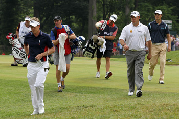 BETHESDA, MD - JUNE 16:  (L-R) Luke Donald and Lee Westwood of England walk with Martin Kaymer of Germany and their caddies off the 18th green during the first round of the 111th U.S. Open at Congressional Country Club on June 16, 2011 in Bethesda, Maryla