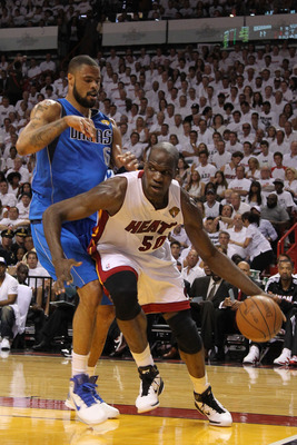 MIAMI, FL - MAY 31:  Joel Anthony #50 of the Miami Heat drives against Tyson Chandler #6 of the Dallas Mavericks in Game One of the 2011 NBA Finals at American Airlines Arena on May 31, 2011 in Miami, Florida. NOTE TO USER: User expressly acknowledges and