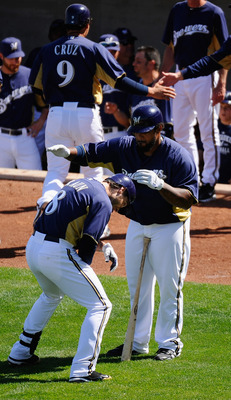 PHOENIX, AZ - MARCH 10:  Ryan Braun #8 of the Milwaukee Brewers is congratulated by teammate Prince Fielder#28 after hitting a three run home run against the Colorado Rockies in the third inning of the spring training baseball game at Maryvale Baseball Pa