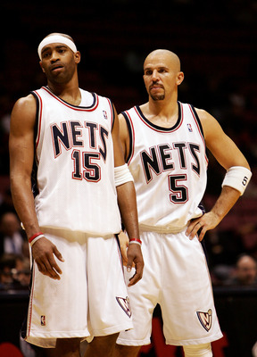EAST RUTHERFORD, NEW JERSEY - NOVEMBER 2: Vince Carter #15 and Jason Kidd #5 of the New Jersey Nets talk against the Milwaukee Bucks on November 2, 2005 at Continental Airlines Arena in East Rutherford, New Jersey. The Bucks defeated the Nets 110-96. NOTE