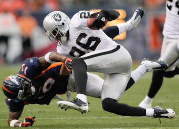 DENVER - OCTOBER 24:  Cornerback Stanford Routt #26 of the Oakland Raiders nearly intercepts a pass intended for wide receiver Eddie Royal #19 in the fourth quarter at INVESCO Field at Mile High on October 24, 2010 in Denver, Colorado. The Raiders defeate
