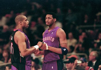 23 Apr 2000: Vince Carter #15 of the Toronto Raptors shakes hands with teammate Tracy McGrady #1 during round one of the NBA Playoffs against the New York Knicks at the Madison Square Garden in New York. The Knicks defeated the Raptors 92-88.   Mandatory