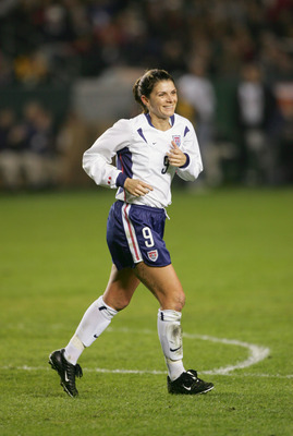 CARSON, CA - DECEMBER 8:  Forward Mia Hamm #9 of the USA smiles as she runs across the field during the 'Fan Celebration Tour' finale against Mexico on December 8, 2004 at The Home Depot Center in Carson, California.  Hamm would retire from the national t