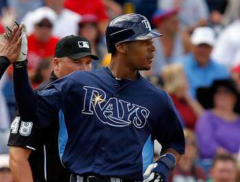 CLEARWATER, FL - MARCH 06:  Outfielder Desmond Jennings #8 of the Tampa Bay Rays is congratulated by teammate Ray Olmedo #16 after scoring a run against the Philadelphia Phillies during a Grapefruit League Spring Training Game at Bright House Field on Mar