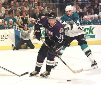 20 Jan 1996:  Peter Forsberg #21 of the Western Conference weaves through Ray Bourque #77, Roman Hamrlik #44 and Eric Lindros #88 of the Eastern Conference in an attempt at a shot during the first period of the NHL All Star Game played at the Fleet Center