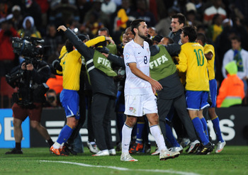 JOHANNESBURG, SOUTH AFRICA - JUNE 28:  Clint Dempsey of USA shows his dejection as Brazil celebrate victory at the end of the FIFA Confederations Cup Final between USA and Brazil at the Ellis Park Stadium on June 28, 2009 in Johannesburg, South Africa.  (