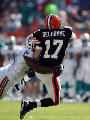 MIAMI - DECEMBER 05: Quarterback Jake Delhomme #17 of the Cleveland Browns is hit by Cameron Wake #91 of the Miami Dolphins at Sun Life Stadium on December 5, 2010 in Miami, Florida.  (Photo by Marc Serota/Getty Images)