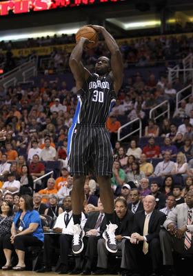 PHOENIX, AZ - MARCH 13:  Brandon Bass #30 of the Orlando Magic puts up a shot during the NBA game against the Phoenix Suns at US Airways Center on March 13, 2011 in Phoenix, Arizona. The Magic defeated the Suns 111-88. NOTE TO USER: User expressly acknowl