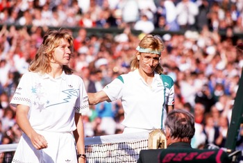 JUL 1988:  STEFFI GRAF OF GERMANY IS PATTED ON THE BACK BY MARTINA NAVRATILOVA OF THE UNITES STATES AFTER THEIR MATCH ON CENTRE COURT DURING THE WIMBLEDON TENNIS CHAMPIONSHIPS. Mandatory Credit: Bob Martin/ALLSPORT
