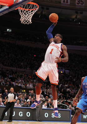 NEW YORK, NY - DECEMBER 22:  Amar'e Stoudemire #1 of the New York Knicks dunks the ball against  the Oklahoma City Thunder at Madison Square Garden on December 22, 2010 in New York City.   NOTE TO USER: User expressly acknowledges and agrees that, by down