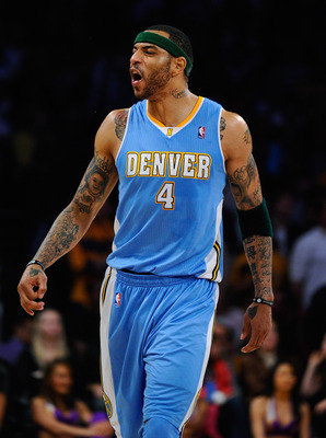LOS ANGELES, CA - APRIL 03:  Kenyon Martin #4 of the Denver Nuggets celebrates after scoring a basket against the Los Angeles Lakers during the NBA basketball game at Staples Center on April 3, 2011 in Los Angeles, California. NOTE TO USER: User expressly