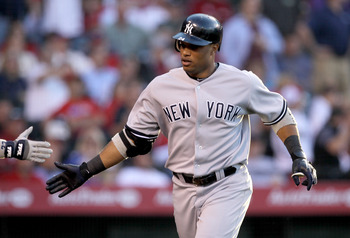 ANAHEIM, CA - JUNE 4:  Robinson Cano #24 of the New York Yankees celebrates as he returns to the dugout after hitting a home run in thhe fourth inning against the Los Angeles Angels of Anaheim on June 4, 2011 at Angel Stadium in Anaheim, California.   (Ph