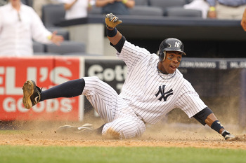 NEW YORK, NY - JUNE 16:  Curtis Granderson #14 of the New York Yankees scores the game winning run from a hit a by Brett Gardner #11 against the Texas Rangers  in the twelfth inning during their game on June 16, 2011 at Yankee Stadium in the Bronx borough