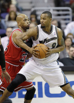 WASHINGTON, DC - FEBRUARY 28: Taj Gibson #22 of the Chicago Bulls guards Rashard Lewis #9 of the Washington Wizards at the Verizon Center in Washington on February 28, 2011 in Washington, DC. NOTE TO USER: User expressly acknowledges and agrees that, by d