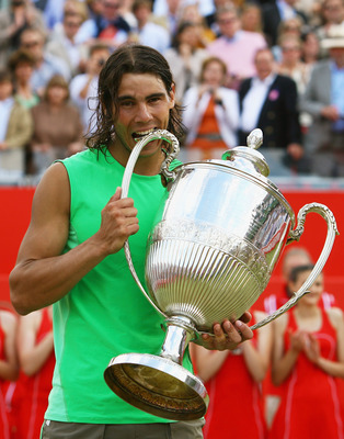 LONDON - JUNE 15:  Rafael Nadal of Spain celebrates with the trophy following his victory during the Men's Singles Final match against Novak Djokovic of Serbia on Day 7 of the Artois Championships at Queen's Club on June 15, 2008 in London, England.  (Pho