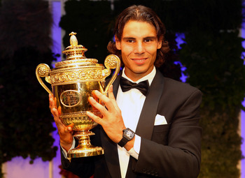 LONDON, ENGLAND - JULY 04:  Rafael Nadal of Spain with the winners trophy at the Wimbledon Championships 2010 Winners Ball at the InterContinental Park Lane Hotel on July 4, 2010 in London, England.  (Photo by Julian Finney/Getty Images)