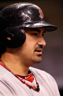 ST. PETERSBURG, FL - JUNE 14:  Infielder Adrian Gonzalez #28 of the Boston Red Sox waits to bat against the Tampa Bay Rays during the game at Tropicana Field on June 14, 2011 in St. Petersburg, Florida.  (Photo by J. Meric/Getty Images)