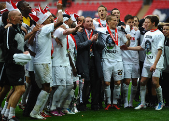 LONDON, ENGLAND - MAY 30: Brendan Rogers (c) of Swansea City celebrates with his players after victory in the npower Championship Playoff Final between Reading and Swansea City at Wembley Stadium on May 30, 2011 in London, England.  (Photo by Laurence Gri