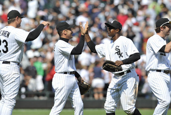 CHICAGO, IL - JUNE 12: L-R  Mark Teahen #23, Omar Vizquel #11, Juan Pierre #1, and Brent Morel #22 of the Chicago White Sox celebrate their victory against the Oakland Athletics on June 12, 2011 at U.S. Cellular Field in Chicago, Illinois. The White Sox d