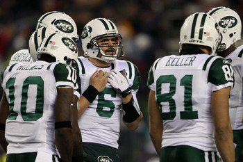 FOXBORO, MA - JANUARY 16:  Quarterback Mark Sanchez #6 of the New York Jets huddles with teammates against the New England Patriots during their 2011 AFC divisional playoff game at Gillette Stadium on January 16, 2011 in Foxboro, Massachusetts.  (Photo by